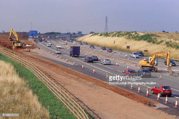 Caterpillar 330B crawler excavator and Hyundai R130W wheeled excavator during construction of M6 motorway northern relief road at M42 junction...