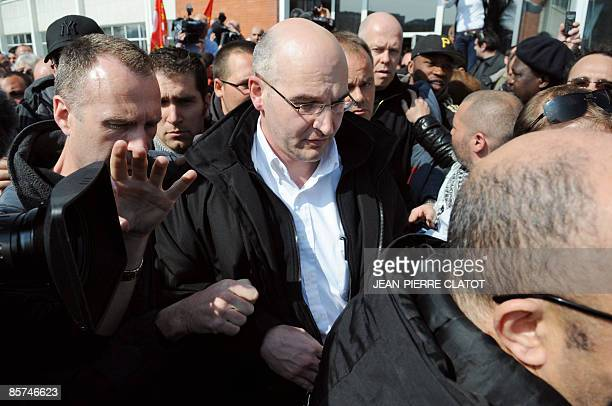 Caterpillar bulldozer plant director Nicolas Polutnik leaves the factory, on April 1, 2009 in Grenoble, where he was held hostage by employees with...