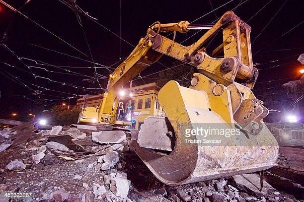 Caterpillar CAT 326L Excavator on a road construction site on Duboce street . Railroad workers were replacing a Muni light rail track section at...