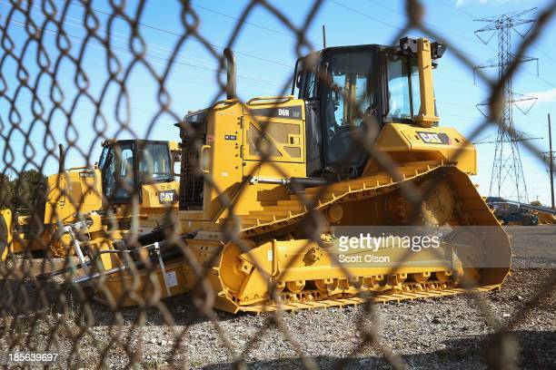 Caterpillar construction equipment sits on the lot of a dealership on October 23 2013 in Elmhurst Illinois Caterpillar Inc reported lowerthanexpected...