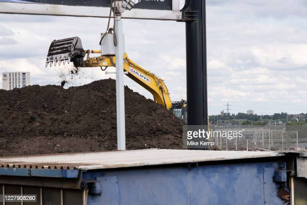 Caterpillar digger working on the construction site for the HS2 mainline station at Curzon Street on 3rd August 2020 in Birmingham, England, United...