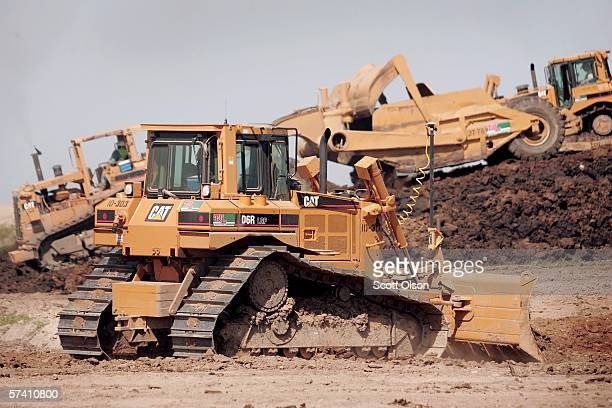 Caterpillar earth moving equipment that is being used to build a road on April 24 2006 near Joliet Illinois Heavy equipment maker Caterpillar...