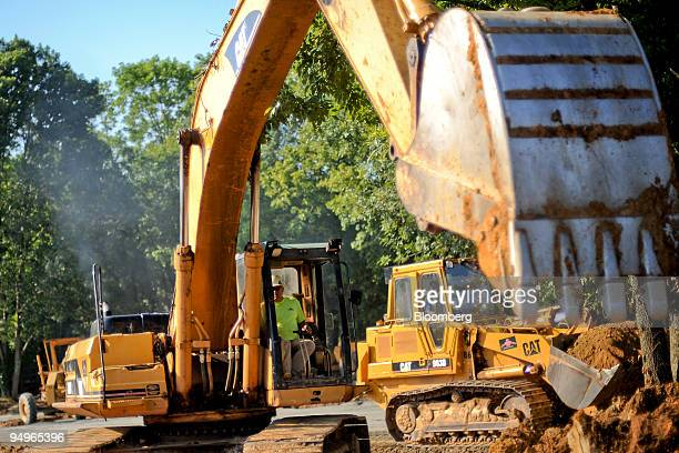Caterpillar excavator is used to grade a parking lot in Buckhead Georgia US on Tuesday July 21 2009 Caterpillar Inc the world's largest maker of...