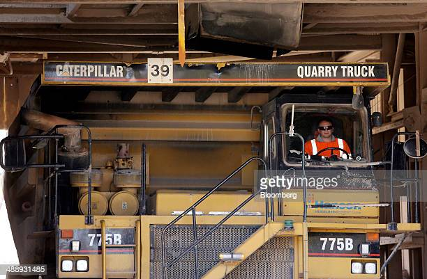 A Caterpillar Inc 775 dump truck sits in a loading bay at Hanson Brickworks' Whatley Limestone Quarry a unit of HeidelbergCement AG near Frome UK on...
