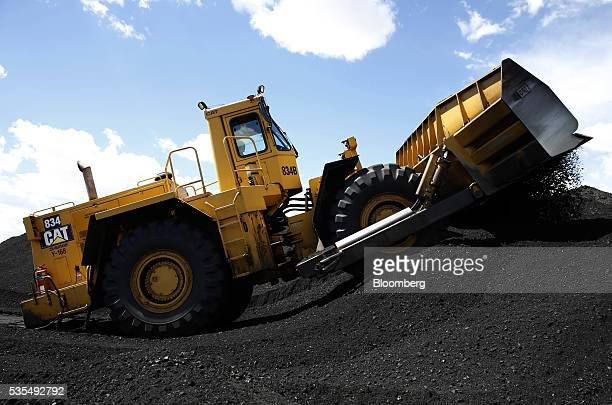 A Caterpillar Inc 834B dozer moves coal at the Savage Industries Co processing facility in Price Utah on Friday May 27 2016 Powerplant demand for gas...