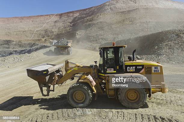 A Caterpillar Inc 938H wheel loader waits to join the road leading to the mine pit at Saracen Mineral Holdings Ltd's Thunderbox gold mine south of...