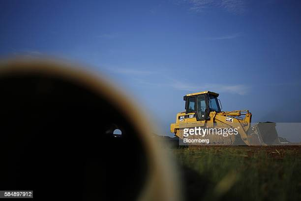 A Caterpillar Inc 963C crawler loader sits parked on a vacant lot in the Norton Commons subdivision of Louisville Kentucky US on Friday July 29 2016...