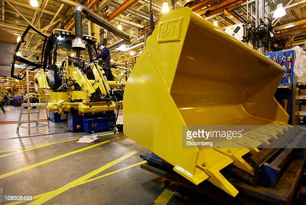 A Caterpillar Inc 'backhoe' digger is assembled on the production line at the factory in Desford UK on Tuesday Jan 25 2011 Caterpillar Inc bulldozers...