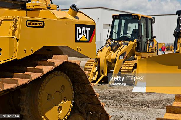 Caterpillar Inc bulldozers sit outside the Altorfer Cat dealership in East Peoria Illinois US on Tuesday July 21 2015 Caterpillar Inc is scheduled to...