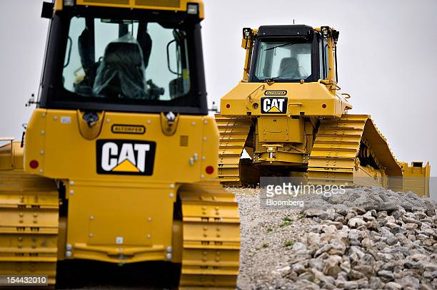 A Caterpillar Inc D6N track type tractor right and a DK52 sit on display at the Altorfer CAT dealership in Bettendorf Iowa US on Friday Oct 19 2012...