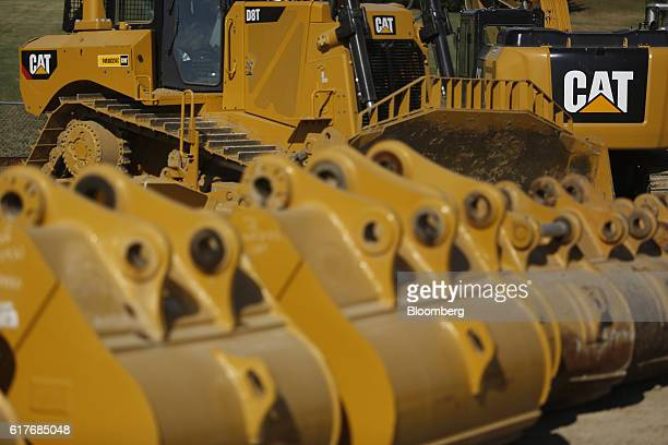 Caterpillar Inc D8T TrackType Tractors sit parked with other rental equipment at the Whayne Supply Co dealership in Lexington Kentucky US on Monday...