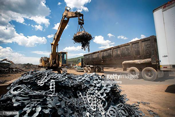 Caterpillar Inc equipment is used to move scrap metal for processing in the yard of Joe Krentzman Son Inc in Lewistown Pennsylvania US on Friday July...