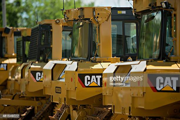 Caterpillar Inc equipment sits outside the Altorfer Cat dealership in East Peoria Illinois US on Tuesday July 21 2015 Caterpillar Inc is scheduled to...
