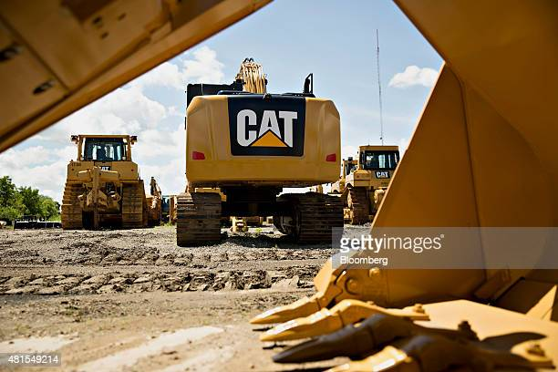 A Caterpillar Inc excavator sits outside the Altorfer Cat dealership in East Peoria Illinois US on Tuesday July 21 2015 Caterpillar Inc is scheduled...