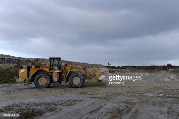 A Caterpillar Inc front end loader sits at a Talison Lithium Ltd site a joint venture between Tianqi Lithium Corp and Albemarle Corp in Greenbushes...