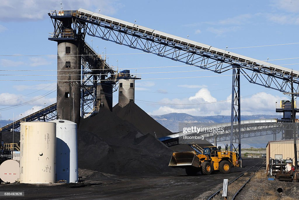 A Caterpillar Inc  front loader moves coal from conveyor