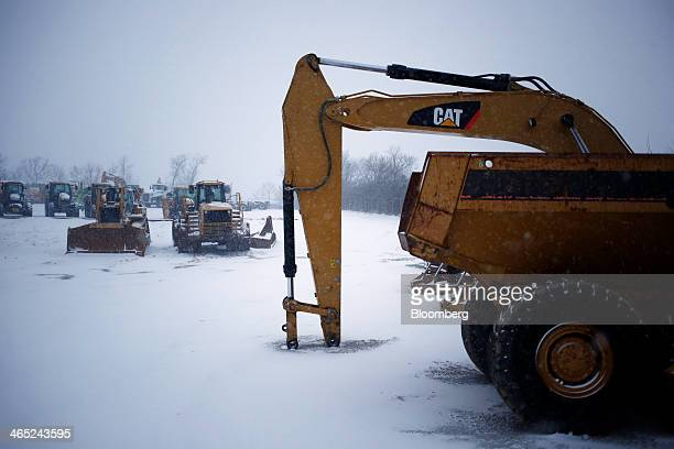 Caterpillar Inc heavy machinery is displayed for sale in the snow at Whayne Supply Company in Lexington Kentucky US on Saturday Jan 25 2014...