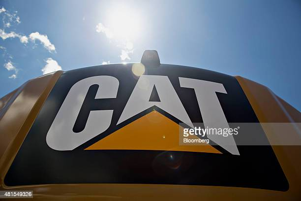 A Caterpillar Inc logo appears on the back of an excavator at the Altorfer Cat dealership in East Peoria Illinois US on Tuesday July 21 2015...