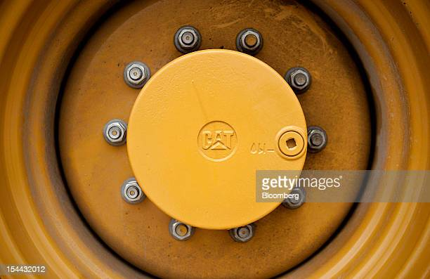A Caterpillar Inc logo is seen on the wheel hub of a piece of equipment on display at the Altorfer CAT dealership in Bettendorf Iowa US on Friday Oct...