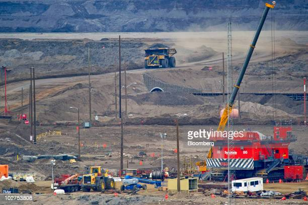 A Caterpillar Inc mining truck carries a load at Syncrude Canada Ltd's oil sands North Mine in Fort McMurray Alberta Canada on Tuesday June 29 2010...