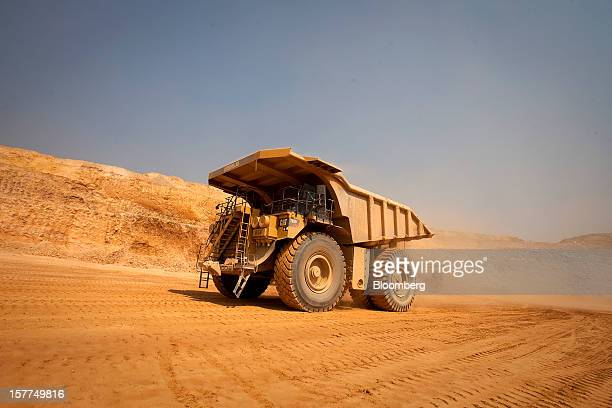 A Caterpillar Inc mining truck leaves for the processing plant after collecting newlyexcavated ore from the open pit at Katanga Mining Ltd's KOV...