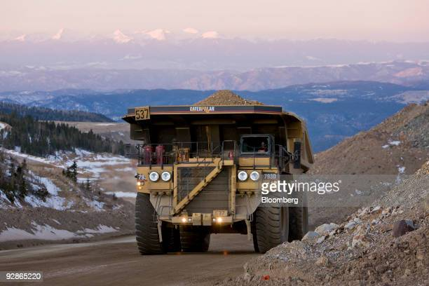 A Caterpillar Inc mining truck moves along a road at the AngloGold Ashanti Ltd Cripple Creek Victor gold mine in Victor/Cripple Creek Colorado US on...