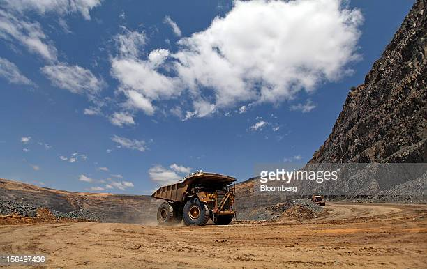 A Caterpillar Inc mining truck moves diamondbearing kimberlite rock from the pit floor to a processing plant at the Jwaneng mine operated by the...
