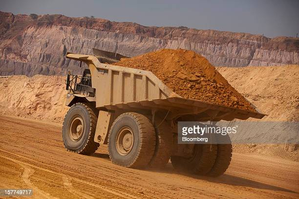 A Caterpillar Inc mining truck removes ore from the open pit area during excavations at Katanga Mining Ltd's KOV copper and cobalt mine in Kolwezi...