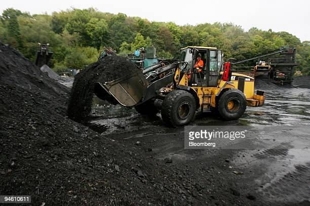 Caterpillar mechanical digger sorts anthracite coal at Aberpergwm Colliery outside Glynneath village in Wales UK on Wednesday Sept 19 2007...