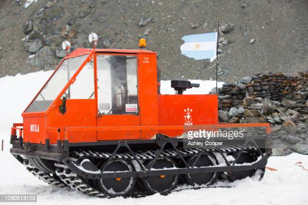 a caterpillar tracked vehicle at base orcadas which is an argentine scientific station in antarctica - south orkney island stock pictures, royalty-free photos & images