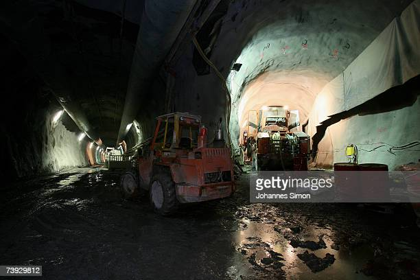 Caterpillars are operate inside the construction site for the Gotthard Base Tunnel on April 19 2007 near Sedrun Switzerland Deep beneath the Alps the...