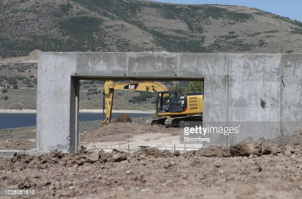 A Caterpiller Inc backhoe stands behind a home under construction in Park City Utah US on Friday Aug 14 2020 US home construction starts rose 17% in...