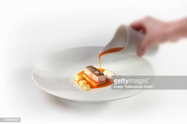 Catfish with a pepper sauce, sour cream ice cream, caraway and potato gnocchi