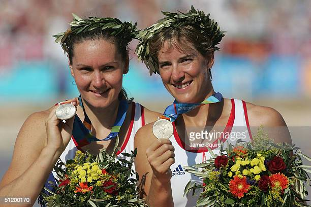 Cath Bishop and Katherine Grainger of Great Britain celebrate winning the Silver medal in the women's pair rowing final on August 21 2004 during the...