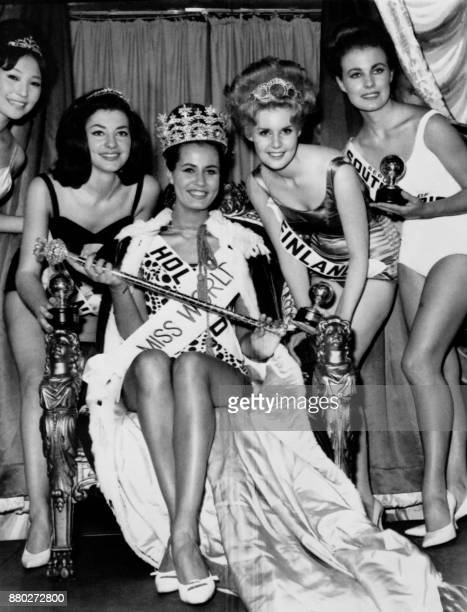 Catharina Lodders from Netherlands flanked by Miss France Monique Lemaire and Miss Finland Kaarina Leskinen reacts after being crowned Miss World...