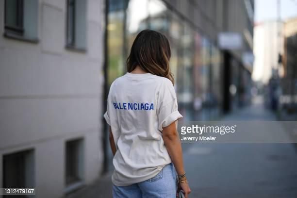 Catharina Maranca wearing beige Balenciaga shirt and Zara destroyed blue jeans on April 11, 2021 in Berlin, Germany.