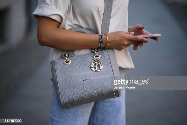 Catharina Maranca wearing beige Balenciaga shirt, Zara destroyed blue jeans and grey Lady Dior bag on April 11, 2021 in Berlin, Germany.