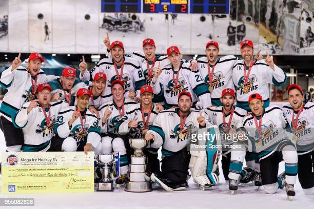 Cathay Flyers squad poses for photos with the champion's trophy during the Mega Ice Hockey 5s International Elite Final match between Nordic Vikings...