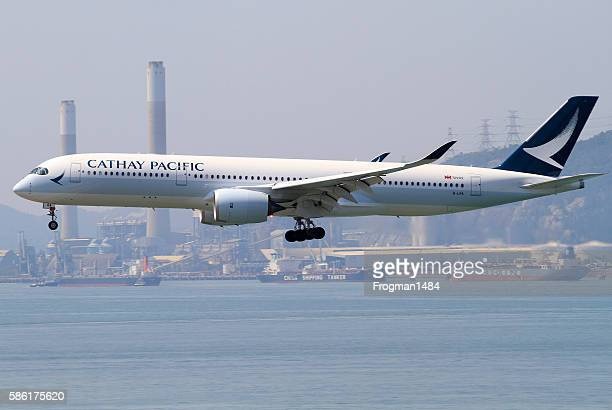 cathay pacific airbus a350-900 - airbus stock pictures, royalty-free photos & images