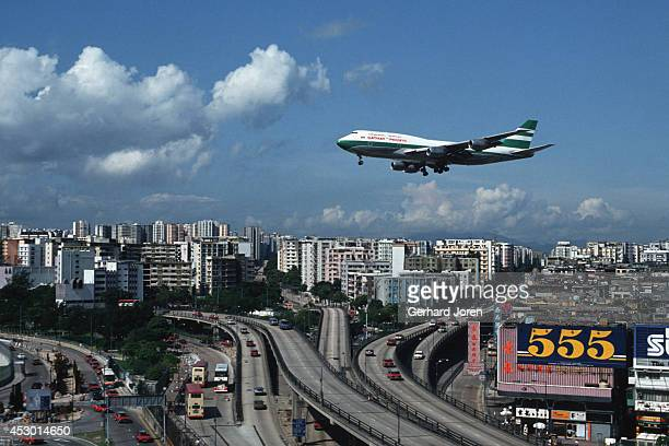 Cathay Pacific Boeing 747 lands at Kai Tak airport in Kowloon Hong Kong The approach over highlypopulated areas is considered one of the most...