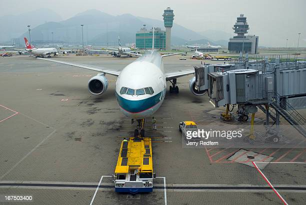 Cathay Pacific Boeing 777 airliner is wheeled away from the gate at Hong Kong International Airport