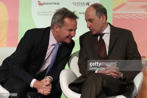 Cathay Pacific CEO Ruper Hogg talks with Qatar Airways CEO Akbar Al Baker during a press conference in London on February 1 with the chief executives...