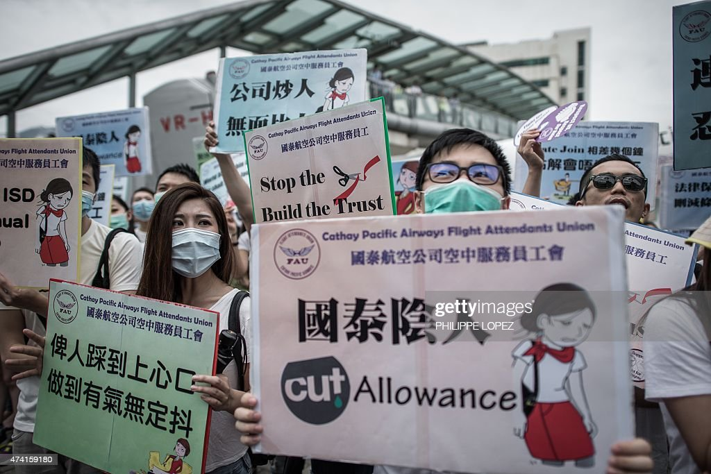 Cathay Pacific flight attendants protest outside the airline's headquarters on the second day of their protest action near the Hong Kong international airport on May 21, 2015. Unionised employees of the flag carrier airline of Hong Kong have vowed to strike in August 2015 if their demands over pay, legal protection and allowances are not resolved. AFP PHOTO / Philippe Lopez