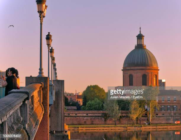 cathedral against dramatic sky during sunset - toulouse stock pictures, royalty-free photos & images