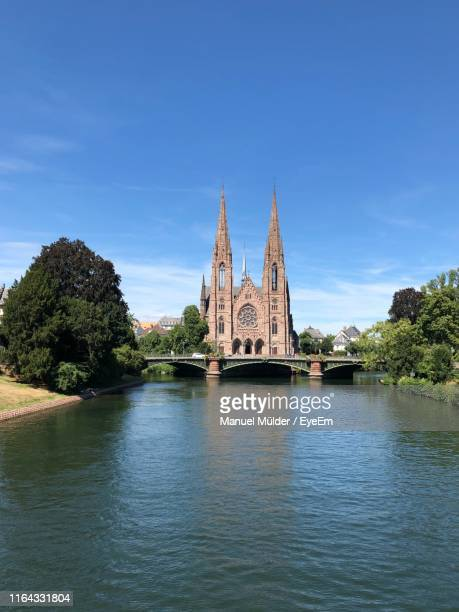 cathedral against sky - strasbourg stock pictures, royalty-free photos & images