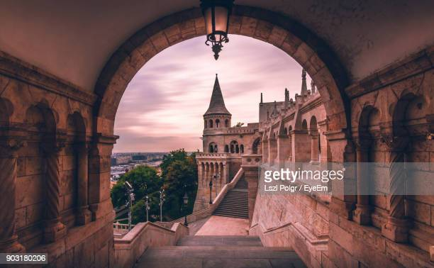 cathedral against sky seen from archway - budapest stock pictures, royalty-free photos & images