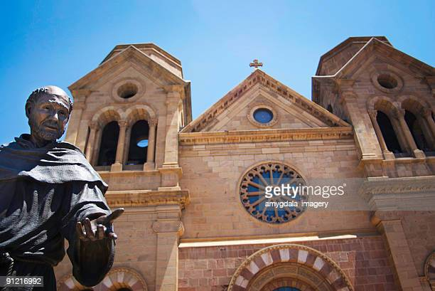 cathedral and saint francis statue - basilica stock pictures, royalty-free photos & images
