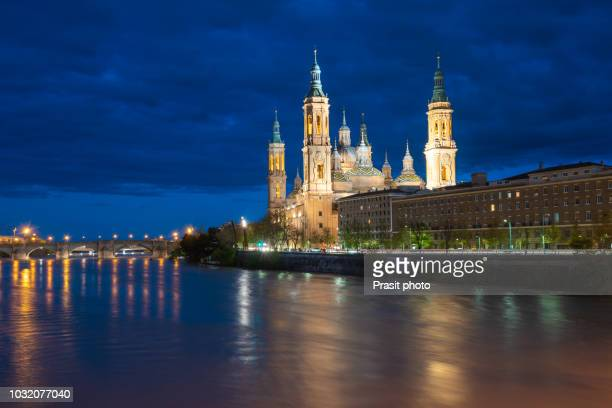 cathedral basilica of our lady of the pillar at night in zaragoza the capital city of of aragon, spain. - zaragoza city stock photos and pictures
