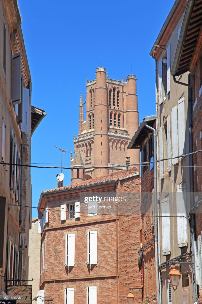 Cathedral bell-tower through Houses, Albi. : Stock Photo