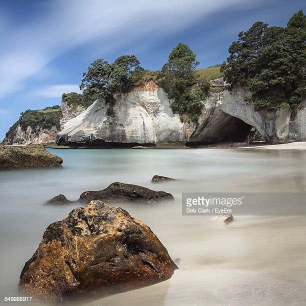 Cathedral Cove By Sea Against Sky